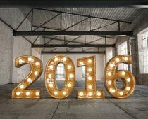 Retro 2016 bulb sign in empty warehouse